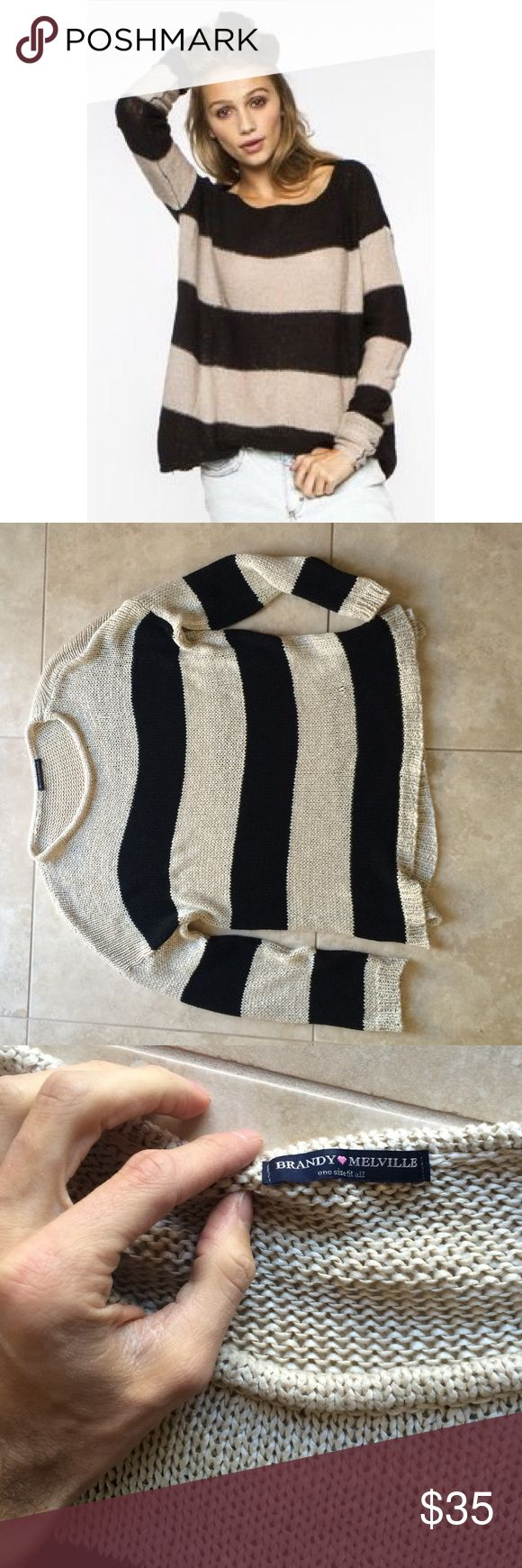 """Brandy Melville oversized striped knit sweater Super cute brandy Melville Creme and black striped knit relaxed fit sweater. One size fits all. Made in Italy. Slightly different from the first stock photo. Can be dressed up or down. So comfy. Sorry I don't model items. Good condition. 70% cotton 30% acrylic. Length 26"""" pit to pit approx 25"""". Priced to sell so unless a very fair offer is submitted, price is pretty firm. Brandy Melville Sweaters Crew & Scoop Necks"""