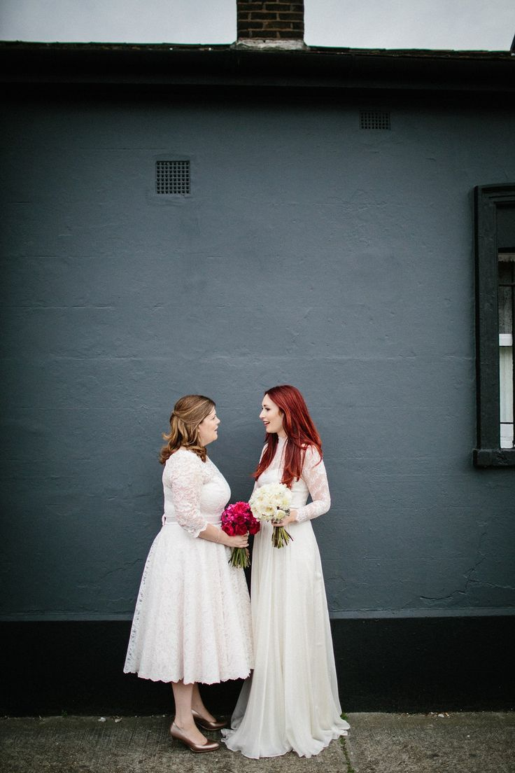 Kate and Lauren married in Catherine Deane and Candy Anthony gowns at Chelsea Town Hall in the Autumn. Photography by Claudia Rose Carter. #claudiarosecarter #realwedding #littlebookforbrides #samesexwedding #50sgown