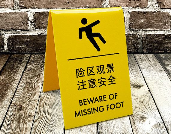 Shoply.com -Funny A-Frame Sign - Chinglish translation - Beware of Missing Foot. Only A$29.95