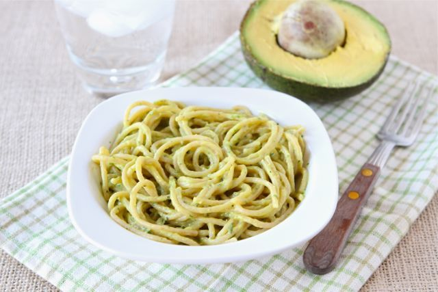 Creamy Avocado Pasta by twopeasandtheirpod: A 15 minute,  healthy, meal with a simple sauce made in a blender/food processor with avocado, garlic, lime juice, and cilantro. This would be pretty with a sprinkle of crushed red pepper or some cherry tomatoes on the side. #Pasta #Avocado_Pasta #twopeasandtheirpod