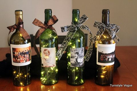 Wine bottles with lights and family photos. Love it.