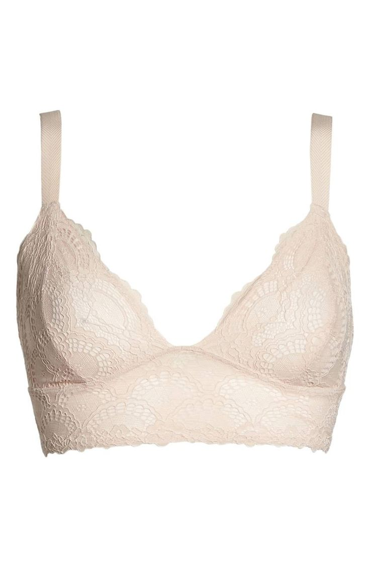 Lounge or layer in this pretty lace bralette supported by a flattering longline band and strappy back.