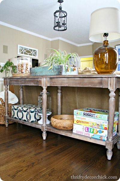 Everett Foyer Table from World Market used as a sofa table.  Extra long and thin.