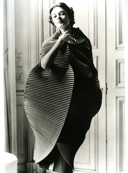 1951, Finely Plisséd Dress opened into a Cocoon, by Elsa Schiaparelli. Photograph by Regina Relang.