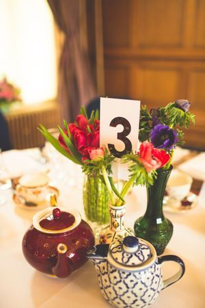 Wedding table centre pieces flowers in vintage jugs and vases