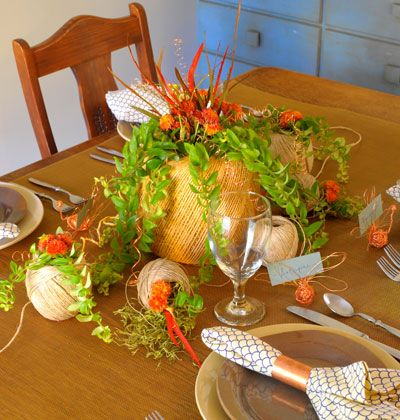 Set up a kids-only table for Thanksgiving. Spread a white paper table covering with plenty of crayons, set out unbreakable tableware, and add a special edible centerpiece and party favors.