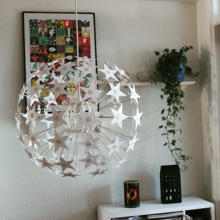 Maskros lamp from Ikea. Stars made from Photo paper, easy to dust of