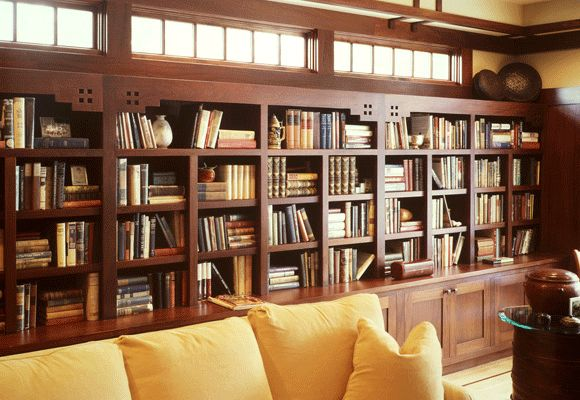 Arts and Crafts Libray Built-In - NePalo Cabinetmakers. Hand crafted custom Arts and Crafts Mahogany Built-in Wall Units with Mantle and Entertainment Center.  This library was built for a book collector, it features the NePalo top detail. Our furniture aims to address the needs and taste of our clients. This is a dream come true for a book collector.