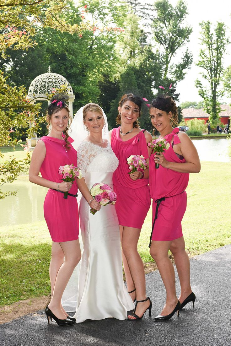 Bright pink dresses for the bridesmaids photographed by Anais Photography