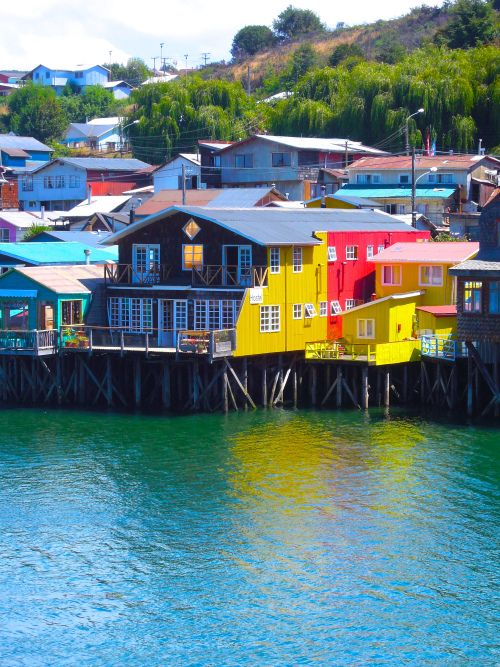 The fun colors of the palafitos made our cameras click way too many times!! Castro, Chiloe