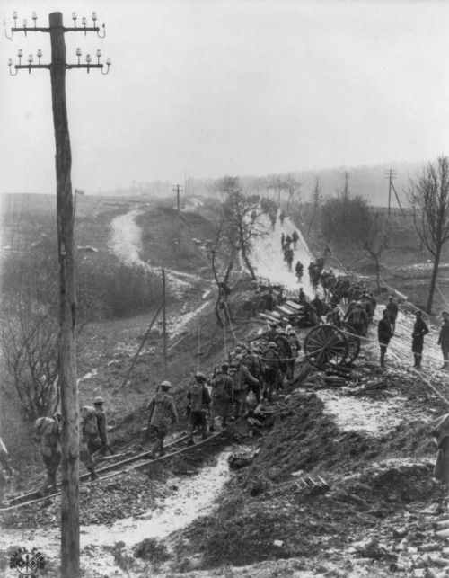 American troops marching along a muddy road in France during World War 1, c. 1918. Source.