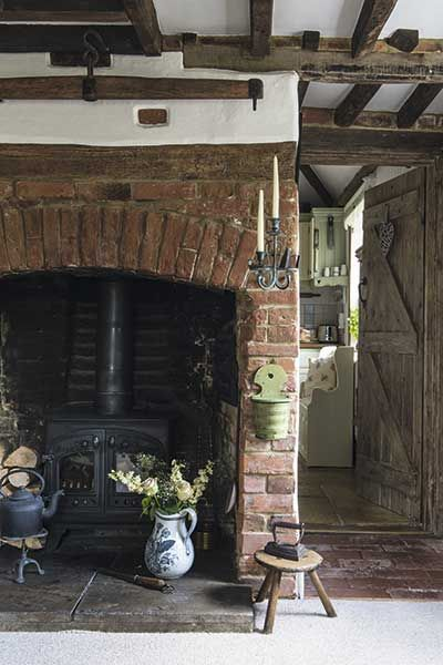 traditional cottage brick inglenook fireplace and woodburner