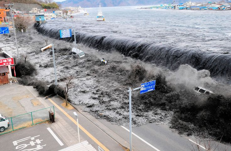 A wave approaches Miyako City from the Heigawa estuary in Iwate Prefecture after the magnitude 9.0 earthquake struck the area March 11, 2011. The earthquake, the most powerful ever known to have hit Japan, combined with the massive tsunami, claimed more than 15,800 lives, devastated many eastern coastline communities, and triggered a nuclear catastrophe at the Fukushima Dai-ichi nuclear power station.
