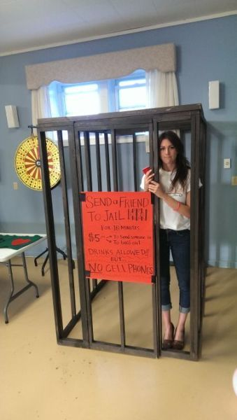 Home made 4' x 6' x 6' (height) wooden jail cell. The idea is that people pay $10 to put someone in for 10 minutes. It worked out VERY well and was hilarious!!  Disassembles into 7 pieces so very easy to set up and take down- all you need is screws and a cordless drill
