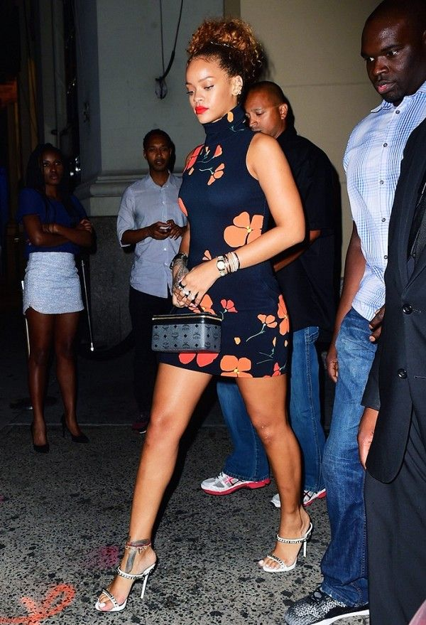 Rihanna wearing a Rodarte floral dress and carrying MCM's Rockstar vanity bag.
