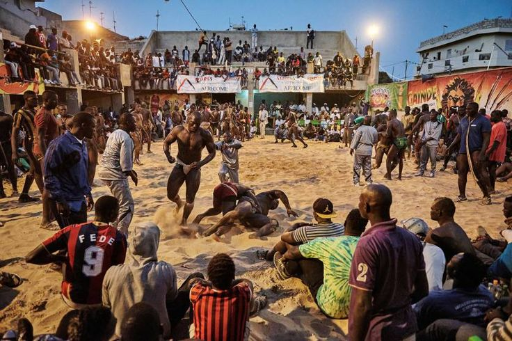 Sports, 2nd prize stories. A tournament in the Adrien Senghor arena leans towards the end. The wrestling fights take place in the late evenings when temperatures drop. Dakar, Sierra Leone, March 28, 2015.