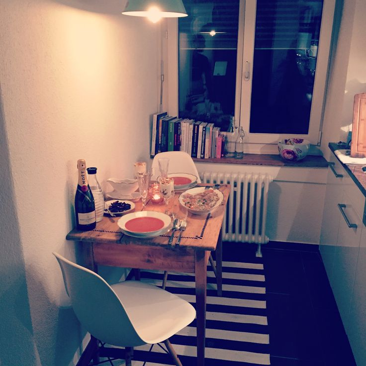 Our new kitchen. Styling for a small kitchen. Wooden table with designer chairs.