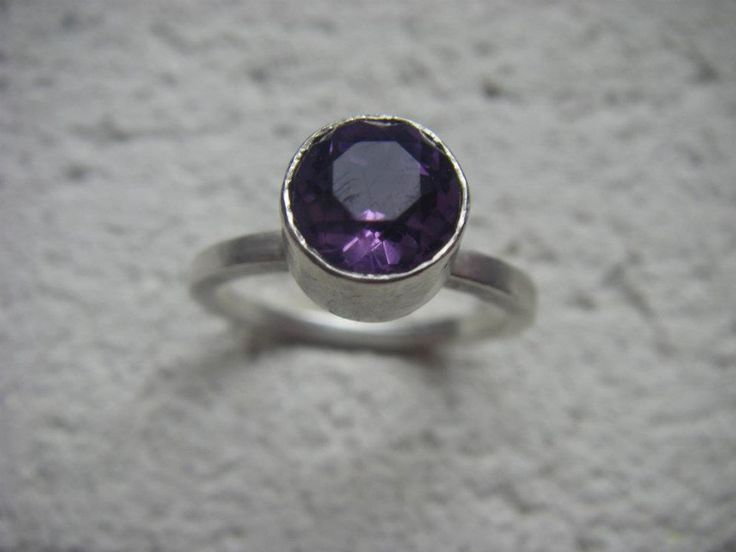Amethyst (February birthstone) in a tall bezel setting.