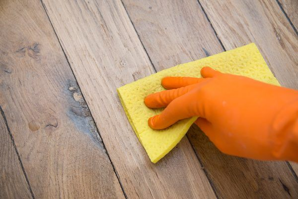 Wax buildup can so discolor a hardwood floor that some people, mistaking the darkness and yellowing for deterioration of the wood, unnecessarily refinish the floor. Old wax also gives vinyl and laminate floors a drab finish, and you may never regain the original vibrancy of these materials until you remove it. Several commercial wax removers are...