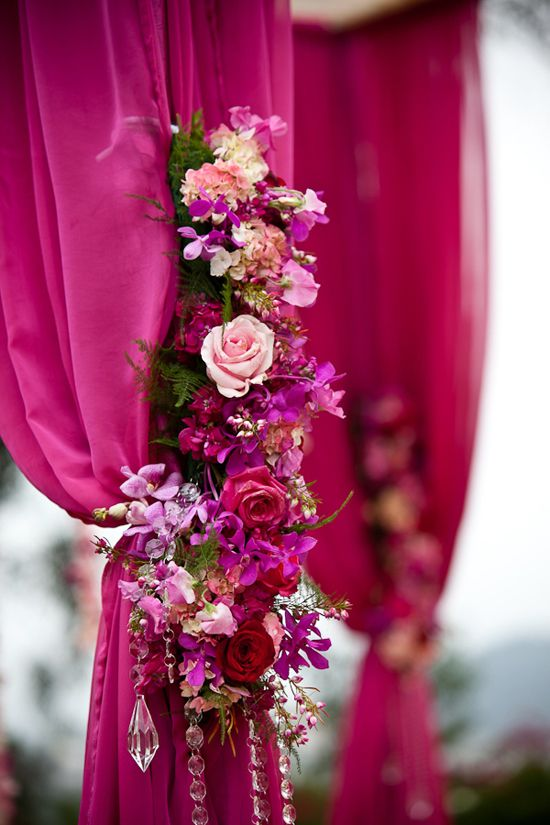 Super pretty, and super easy to do. Or, just choose the colour you'd want your drapes to be. :) Then pick flowers from the same family of colours. Here, we have magenta drapes and pink-purple-magenta-lavender flowers.