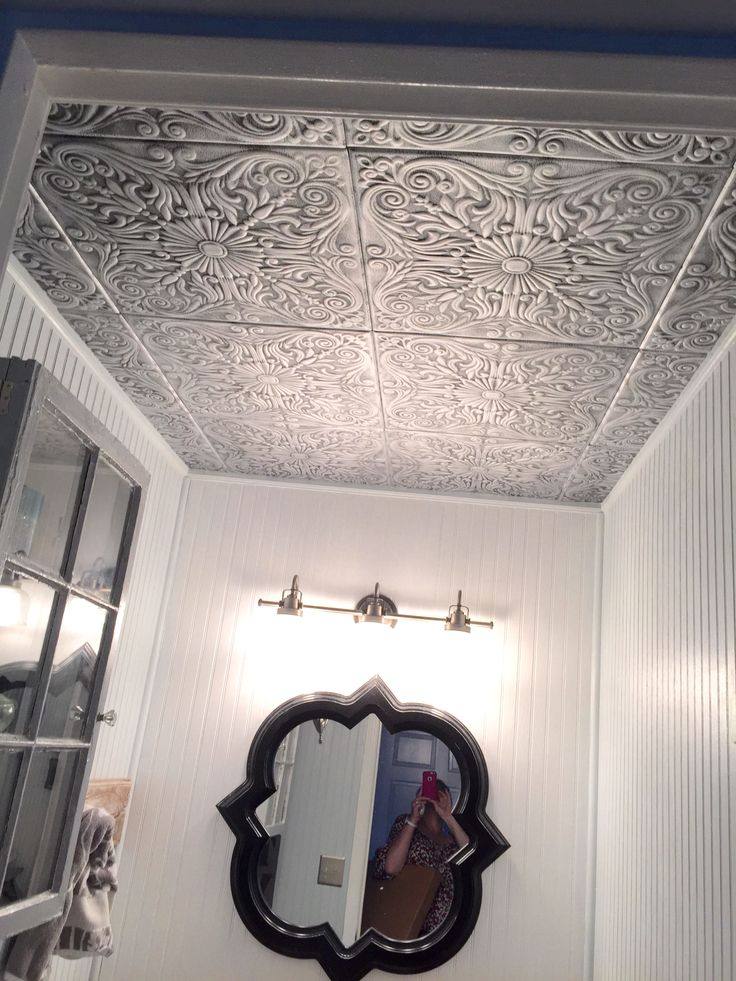 POWDER ROOM BATH - remedy for popcorn ceiling. This was quick and easy. I removed the popcorn first (what a messy project) but these ceiling tiles can go right over if you don't want to remove the texture. It only took an hour to install the tiles.
