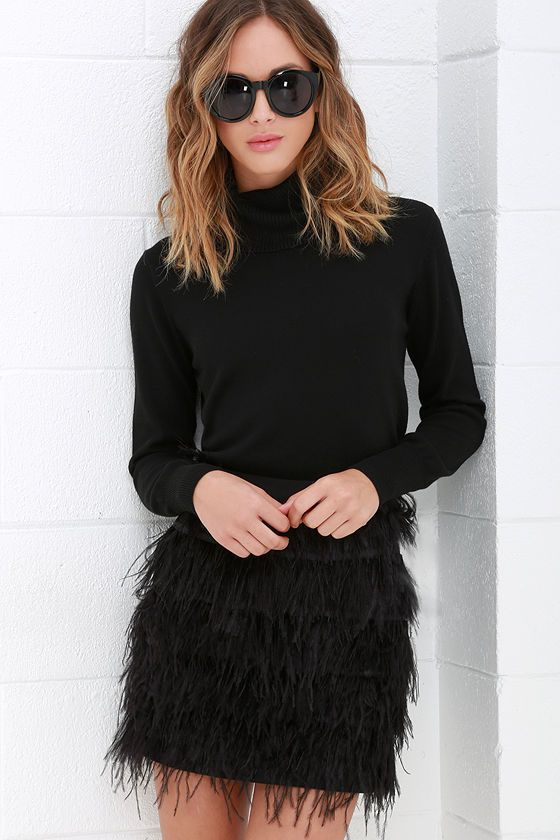 all black outfit with a black feather mini skirt