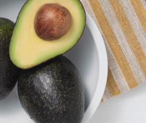 Fire up some coals and sear some ripe Hass avocados for an unexpected grilled treat during a summer cookout.  Grilled avocados