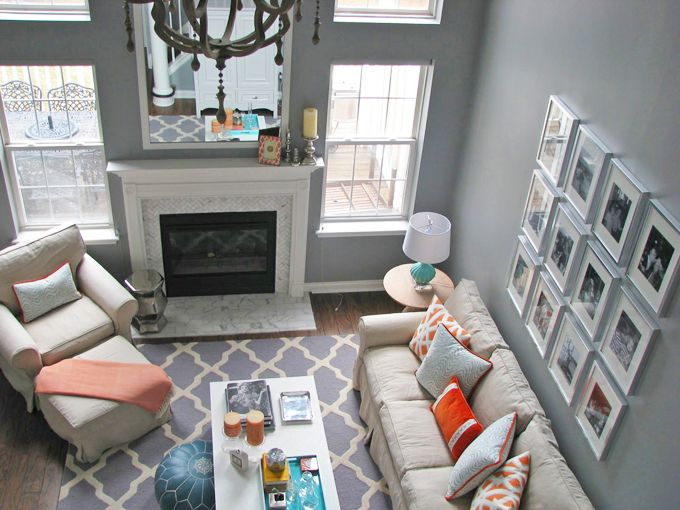 Neutral grey walls and furniture with punches of colour in the throw pillows and blanket.