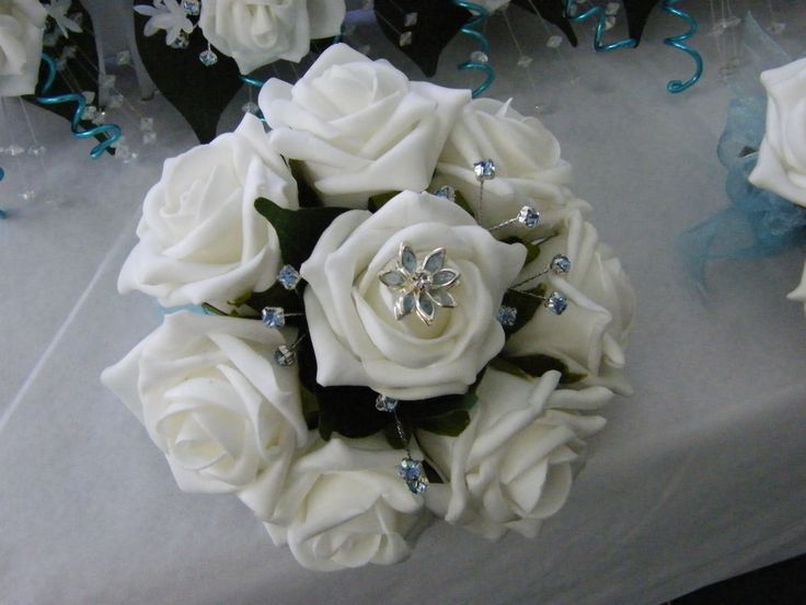 This is an example of our Artificial Rose Bouquet in white with a touch of Pale Blue