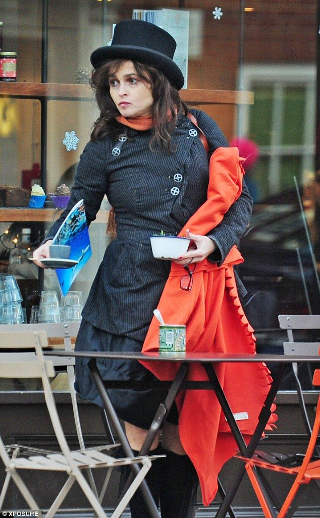 Eccentric style: HBC kept herself warm in a pinstriped flared overcoat, which she teamed with a puffy knee-length skirt. Jan 2015