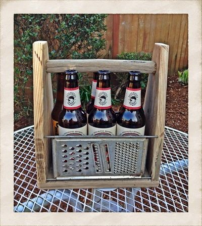 Bottle caddy/tote made from reclaimed wood & old cheese graters. #upcycle…