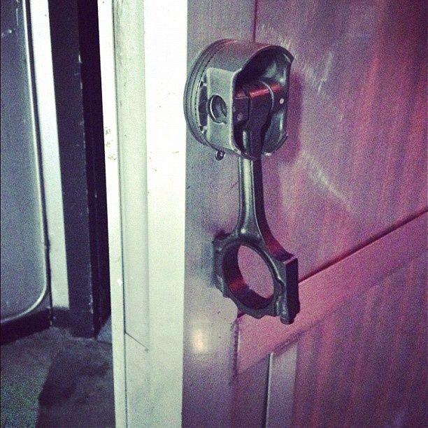 Nothing screams Man-Cave like a car part for a door knob! Piston Door handle…