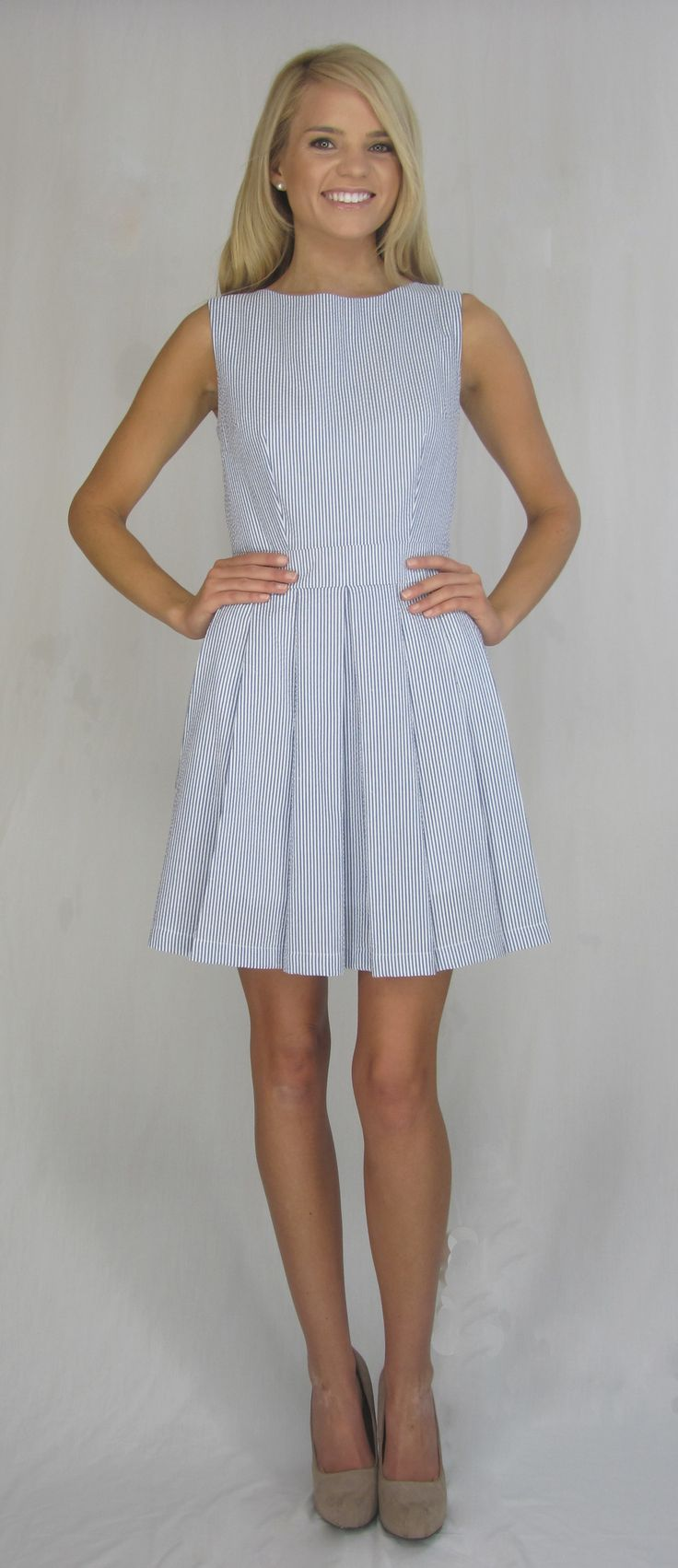 Pleated blue seersucker dress.