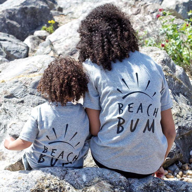 "Beach Bum T-Shirt | Bums on holiday come in all shapes and sizes, but the kid in the ""Beach Bum"" t-shirt is going to be the smartest dressed kid on the sand. This is an outstandingly individual, unisex piece of holiday wear, designed to feel comfortable and relaxed while looking suitably stylish and bold with its handprinted lettering on the back. Plus, as it comes in a range of sizes, it's suitable for adults who want to display their inner beach bum too 