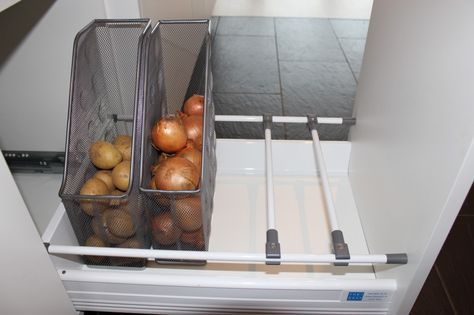 Photo of Store potatoes and onions in magazine holders