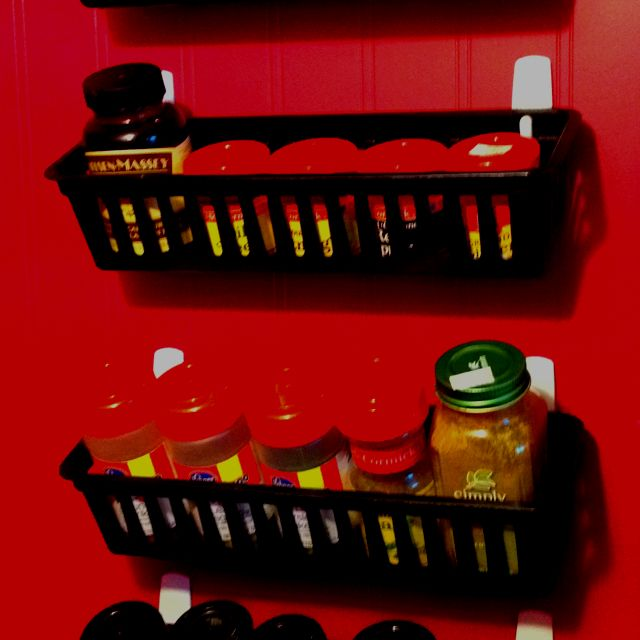 """Our new """"spice rack""""...we have very little cupboard space & they were taking up an entire shelf. The black containers come in a set of 3 at Walmart for $1 (same at Dollar Tree but only in white). The 3M Command Strips were pricey ($8 for a 8pk) but I don't like nailing things to the wall in case I change my mind"""