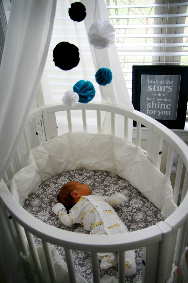 Round bassinet w/ wheels - converts into a crib & toddler bed. Plus the sign in the back! ahhhh!