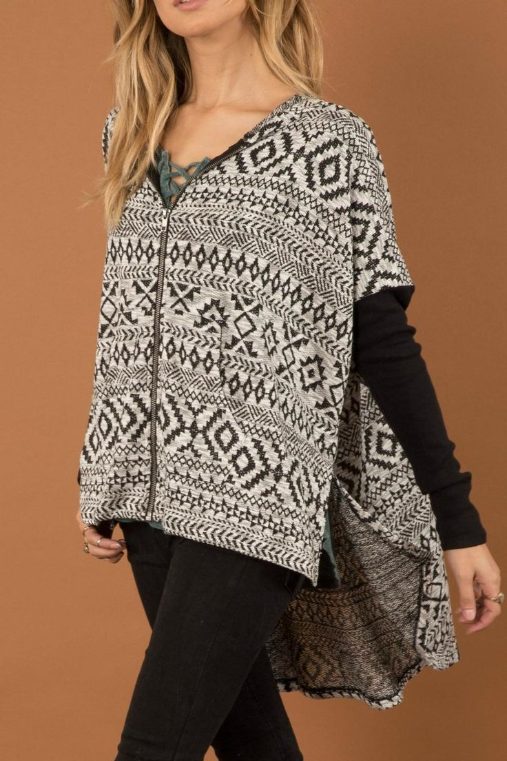 This grey printed zip up has a hi low hemline and a hood. The sleeve is a solid black. Pair with skinny jeans!   Grey Aztec Zip by White Crow. Clothing - Tops - Long Sleeve New Jersey