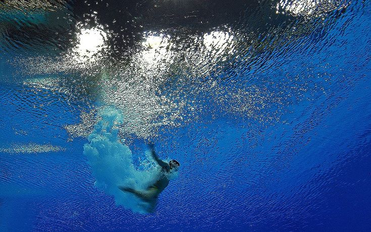 2012 London Olympics - Matthieu Rosset of France competes in the men's 3m springboard diving semifinal