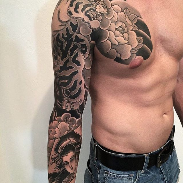 Japanese tattoo sleeve by @goshu34.  #japaneseink #japanesetattoo #irezumi #tebori #bngink #blackandgrey #blackandgreytattoo #cooltattoo #largetattoo #armtattoo #chesttattoo #tattoosleeve #tigertattoo #flowertattoo #peonytattoo #geishatattoo #wavetattoo #naturetattoo