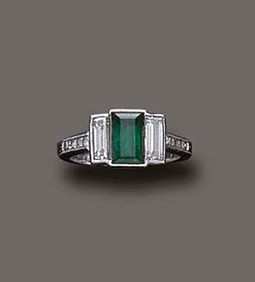 AN ART DECO EMERALD AND DIAMOND RING, BY TIFFANY & CO.   Centering upon a rectangular-cut emerald, flanked on either side by baguette-cut diamonds, mounted in platinum, circa 1920  Signed Tiffany & Co. (=)