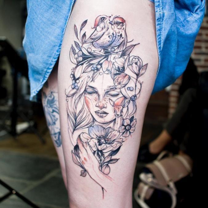 Birds and portrait thigh tattoo