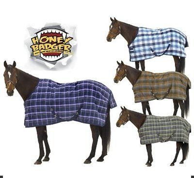 Honey Badger 840D Medium Weight Turnout Lavender Plaid, 78 by Centaur. $118.75. The Honey Badger Medium Weight Turnout is the turnout with an attitude! Honey Badger don't care about the weather, and neither should your horse! The outer shell is a rugged 840D polypropylene guaranteed for a full year against tearing and failure of the waterproofing. This turnout is designed to handle whatever your horse and the elements throw at it! Features of the Honey Badger Turnout includ...