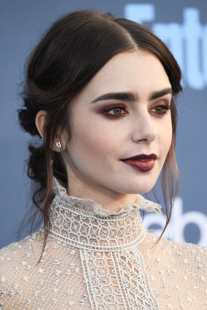 Lily looked like a sexy vampire thanks to matte plum shadow that provided a stark contrast with her porcela...