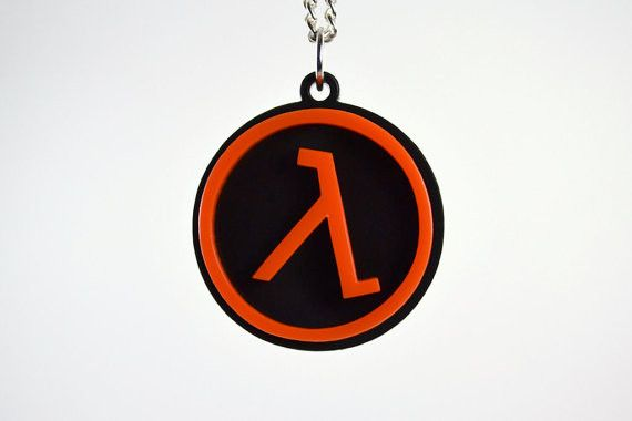 "LicketyCut Proudly Presents The Half Life Lambda Pendant Necklace The Half Life Lambda Pendant Necklace is laser cut from three pieces of 1/8"" Acrylic and measures 1"" square. The Orange Lambda Symbol"