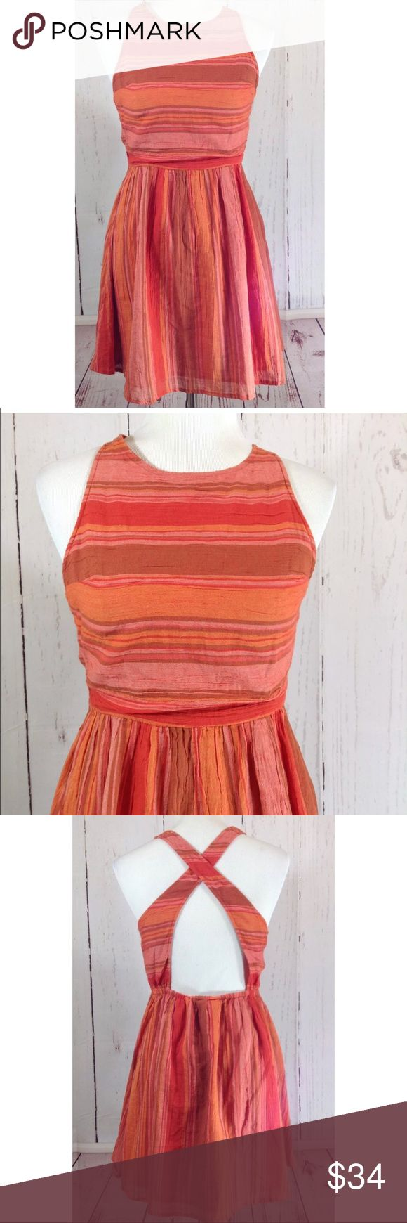 "NWT Roxy Criss Cross Back Dress Size Medium NWT Roxy Size Medium Dress Orange Stripe Criss Cross Open Back Cotton Gauze Fully lined  Shown on a medium size mannequin  Approximate flat measurements:  Chest: 16"" Waist: 13.5"" Hips: 21.5"" Length: 34"" Roxy Dresses Backless"