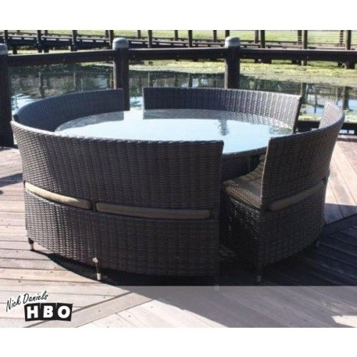 Orbit Round Outdoor Table Setting  Be the first to review this product  Stylish Orbit Round outdoor wicker table setting. Features a large round glass top table and curved chairs with plush seat cushions. Made to order 8 to 10 week wait