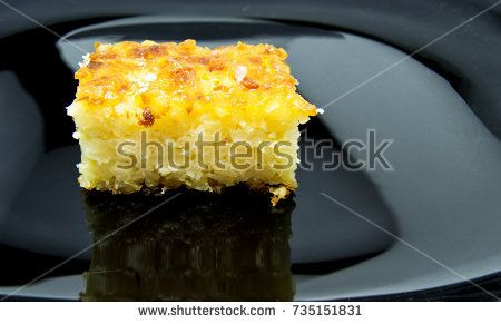 Baked rice pudding dessert sweetened with sugar powder on black dish. for food concept