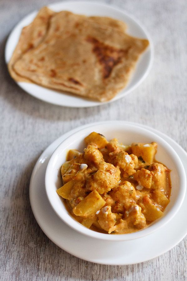 aloo gobi restaurant style recipe. a rich creamy curry made with cauliflower and potatoes. #curry