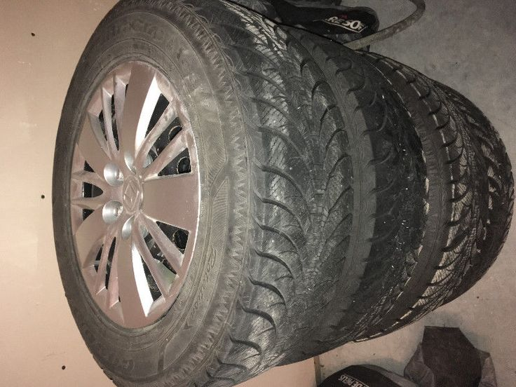 set of 4 gently used 235/65r17 goodyear ultra grip ice wrt on steel rims with genuine honda wheel covers, nitrogen filled, lug nuts, tire pressure monitors and honda wheel totes. (retail tires $200)